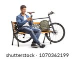 young man with a phone and a...   Shutterstock . vector #1070362199