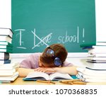 young schoolboy sitting writing ... | Shutterstock . vector #1070368835