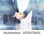 handshake on abstract city... | Shutterstock . vector #1070373431