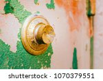 old rough security safe dial | Shutterstock . vector #1070379551