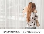 lonely little girl with toy...   Shutterstock . vector #1070382179