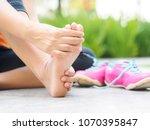 soft focus woman massaging her... | Shutterstock . vector #1070395847
