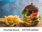 large juicy burger with two... | Shutterstock . vector #1070416064