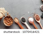 superfood in spoons over gray... | Shutterstock . vector #1070416421