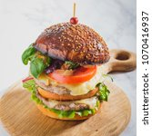 large juicy burger with two... | Shutterstock . vector #1070416937