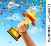 hand holding award of winner on ... | Shutterstock .eps vector #1070420975