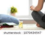 cup of white tea near woman... | Shutterstock . vector #1070434547