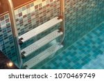 swimming pool with sunny. | Shutterstock . vector #1070469749