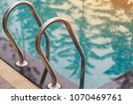 swimming pool with sunny. | Shutterstock . vector #1070469761