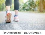 woman runner feet exercising to ... | Shutterstock . vector #1070469884