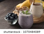 glasses of berry smoothie with...   Shutterstock . vector #1070484089