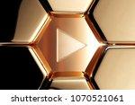 golden arrow play icon in the... | Shutterstock . vector #1070521061