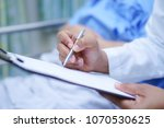 doctor writing down the... | Shutterstock . vector #1070530625
