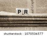 abbreviation pr on newspapers... | Shutterstock . vector #1070536577