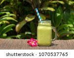 avocado green shake or smoothie ...   Shutterstock . vector #1070537765
