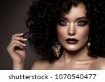 beauty young woman with curly... | Shutterstock . vector #1070540477