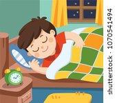 a little boy sleeps in the... | Shutterstock .eps vector #1070541494