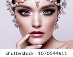 portrait of a beautiful fashion ... | Shutterstock . vector #1070544611
