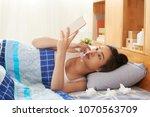 sick vietnamese woman lying in... | Shutterstock . vector #1070563709