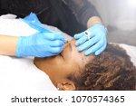 professional beautician woman... | Shutterstock . vector #1070574365