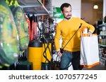 smiling guy deciding on best... | Shutterstock . vector #1070577245