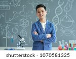 confident teenage student... | Shutterstock . vector #1070581325