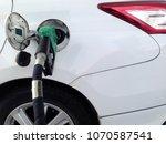 white car fuel filler at fuel...   Shutterstock . vector #1070587541
