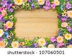 frame of summer flowers on... | Shutterstock . vector #107060501