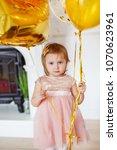 little girl in white dress in... | Shutterstock . vector #1070623961