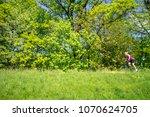 woman cycling a mountain bike... | Shutterstock . vector #1070624705