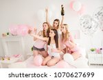 Small photo of Pretty, charming, stylish, attractive, cheerful girls in night wear celebrating holiday, event, shooting self portrait on front camera, using smart phone, sending, blowing kiss with pout lips