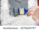 man is painting and renewing a... | Shutterstock . vector #1070634797