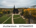 old wooden church and green... | Shutterstock . vector #1070668505