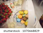 macaroons on table with... | Shutterstock . vector #1070668829