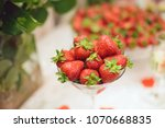 glass with frest strawberry on... | Shutterstock . vector #1070668835