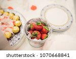 metal vase with strawberry on... | Shutterstock . vector #1070668841