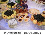 pastry and fruits on festive... | Shutterstock . vector #1070668871