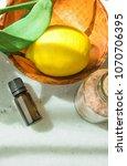 ripe yellow lemon green leaves... | Shutterstock . vector #1070706395