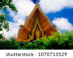 Small photo of Wat Tum Sua Thai beautiful temple with a big Buddha statue in Kanchanaburi province. Most of Thai people will go to pray for his life to get a best wish all the time