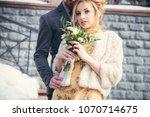 a walk of the newlyweds near an ... | Shutterstock . vector #1070714675