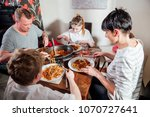 british family enjoying a... | Shutterstock . vector #1070727641
