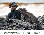 galapagos iguana and tourist... | Shutterstock . vector #1070734634