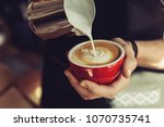 barista in the coffee house...   Shutterstock . vector #1070735741