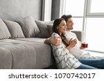 image of attractive man hugging ...   Shutterstock . vector #1070742017