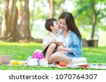 boy child kissing his mom... | Shutterstock . vector #1070764307