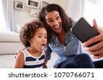 young mother and toddler... | Shutterstock . vector #1070766071