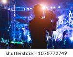 cameraman shooting video action ...   Shutterstock . vector #1070772749