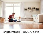 father playing ukulele with... | Shutterstock . vector #1070775545