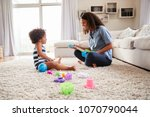 young black mother playing with ... | Shutterstock . vector #1070790044