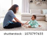 mixed race mum and toddler son... | Shutterstock . vector #1070797655